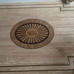 red oak floor installation with custom design