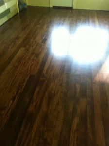 hardwood floor finished with antique brown stain
