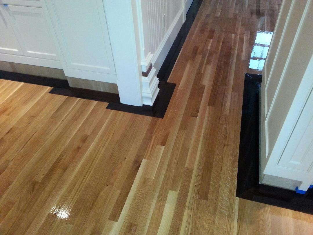Rift sawn white oak flooring with quot walnut border in