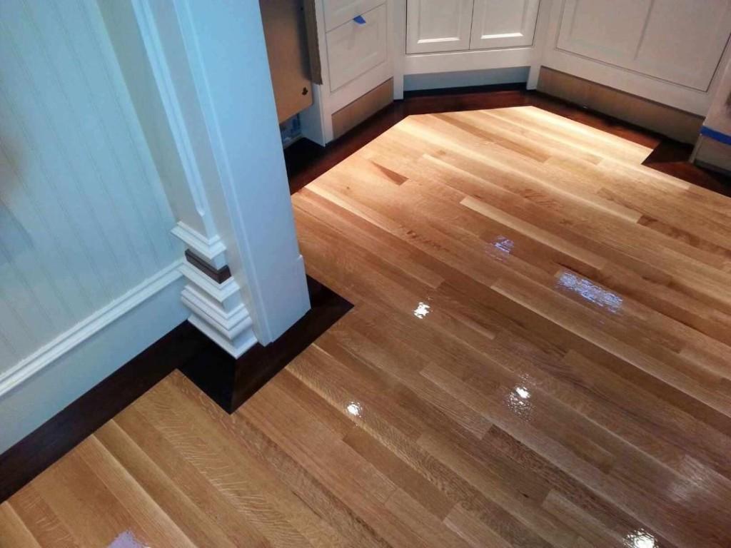 Rift sawn white oak flooring with 5 walnut border in for Oak flooring company