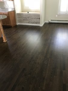2-inch white oak flooring sanded with Jacobean stain and finished with Bona Traffic