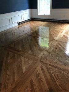 Custom installation. 2-inch white oak flooring with nutmeg stain. oil based polyurethane for finish