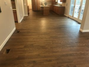 Red oak flooring finished with medium brown satin and Bona Traffic finish