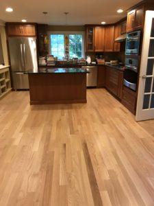 Red oak in kitchen. Bruce white oak pegged flooring