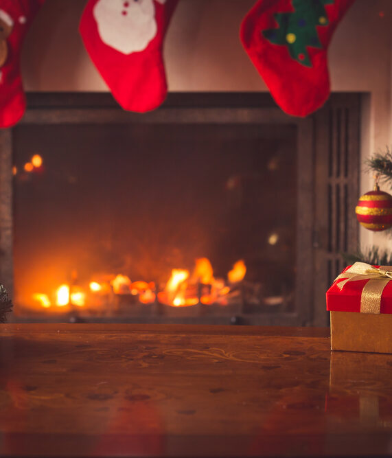hardwood floors and a fireplace during the holidays